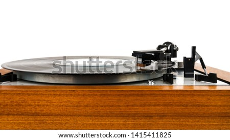 Close up of vintage turntable vinyl record player isolated on white. Wooden plinth. Retro audio equipment.