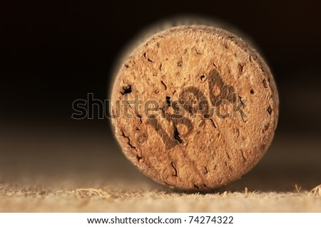 Close-up of vintage wine cork on old wooden surface.