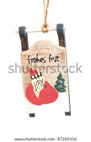 Close-up of vintage wooden christmas sleigh decoration hanging