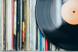 Close up of vinyl record with records collection