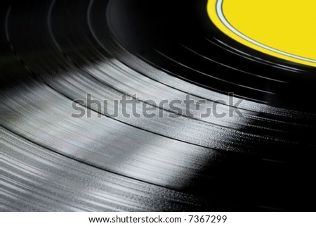 Close-up of vinyl record with yellow label.  Groovy detail!