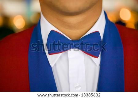 Close-up of waiter's uniform on a luxury cruise ship