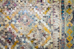 Close up of wall is decorated with old stained glass small plate Traditional Thai old mosaic art on the wall of temple.