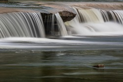 Close up of water cascading through crevices at Callaghan's Rapids Marmora Ontario Canada in summer