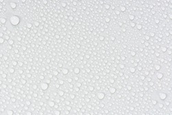 Close up of water drops on gray tone background. Abstarct white wet texture with bubbles on window glass surface or grunge. Raindrop, Realistic pure water droplets condensed for creative banner design