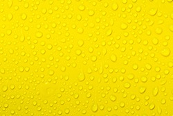 Close up of water drops on yellow tone background. Abstract orange wet texture with bubbles on plastic PVC surface or grunge. Realistic pure water droplets condensed. Detail of canvas leather texture