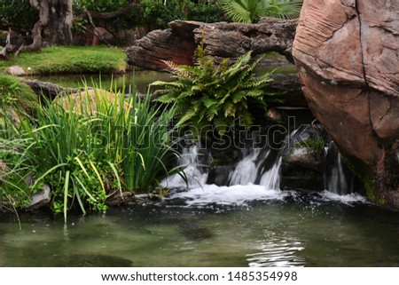 Close up of water flowing in a stream #1485354998