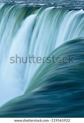 Close up of water rushing over Horseshoe Falls, Niagara Falls, Ontario, Canada