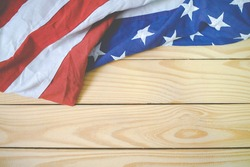 Close up of waving national usa american flag. The flag of the United Sates of America on a grey plank background with memorial day.