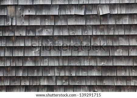 Close up of weathered cedar shingled side of home in Eastport, Maine, USA.