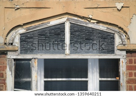 Close up of  weathered stone lintel and glass panel from an English house. Close up of a  weathered stone lintel and glass panel from the outside of a porch of an English suburban house.