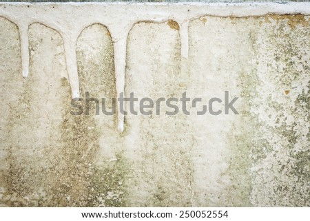 close up of weathered trickle paint on concrete wall ストックフォト ©