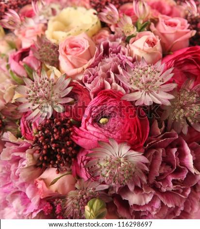 close-up of wedding bouquet with Astrantia, Skimma, Brassica, rose bush, Ranunculus asiaticus, cloves,