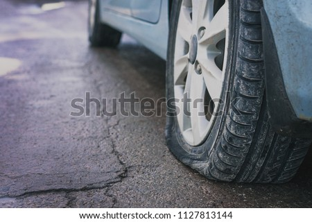 Close up of wheel of car tire leak from puncture. Rear view. #1127813144