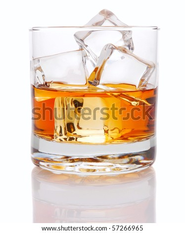 Close up of whiskey in Glass of Ice Cubes with reflection isolated over white