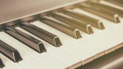 Close-up of white and black piano or synthesizer keys. Musical instrument. Hobbies music.