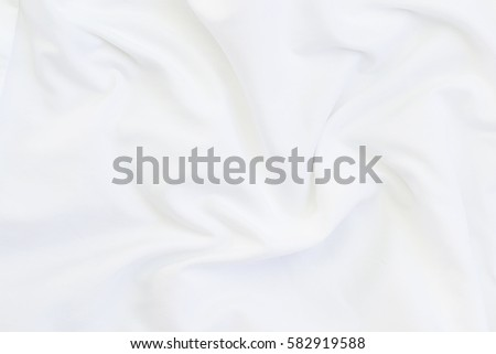 Close up of white bedding sheets and copy-space