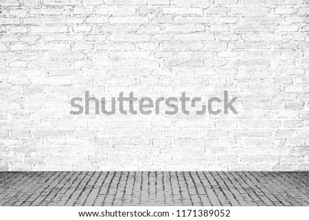 Close up of  white brick wall and old concrete floor, interior room #1171389052