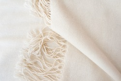 close up of white cashmere wool - fashion background - tassels detail