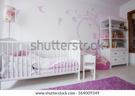 Close-up of white crib in cozy nursery