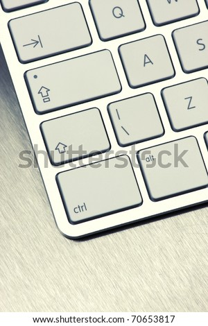 Close-up of White keyboard on metal background