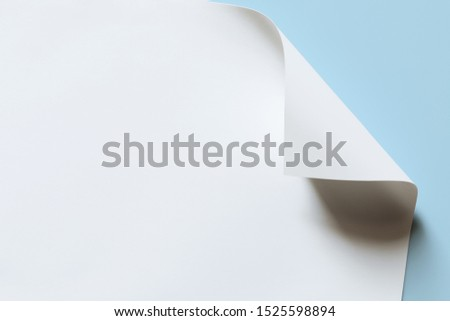 Close-up of white paper with bent corner, texture background #1525598894