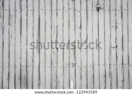 Close up of white vertical  wooden fence panels