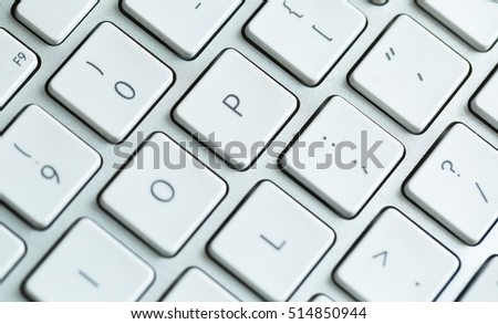 Close up of white wireless aluminum keyboard photographed with shallow depth of field. #514850944
