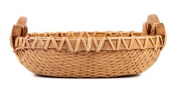 Close up of wicker basket. Isolated on a white background.
