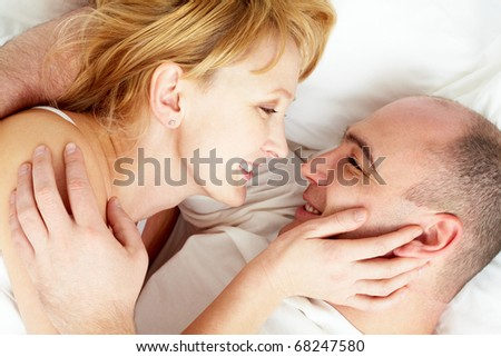 Close-up of wife and husband looking at each other with love #68247580