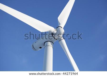 Close up of wind turbine in a windfarm against a clear blue sky