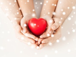close up of woman and man hands with heart
