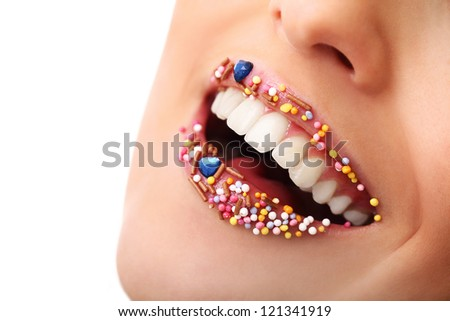 Close up of woman beautiful smile and lips with multicolored pearls