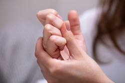 Close-up Of Woman Cracking Their Knuckles At Home