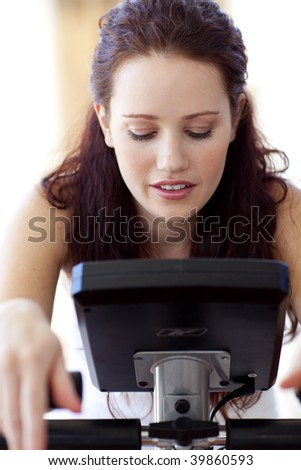 Close-up of woman doing spinning in her bedroom at home