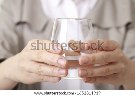 Close up of woman drinking glass of water