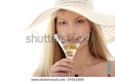 Close-up of woman drinking martini with olive