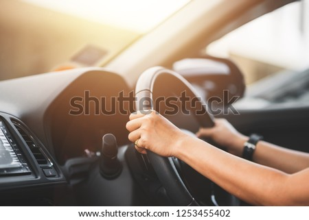 Close Up of Woman Driving a Car on Road - Transportation Concept #1253455402