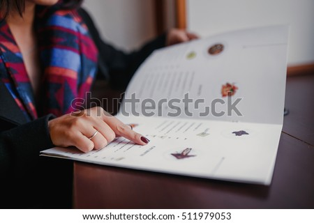 close up of woman finger with menu choosing dishes at restaurant #511979053