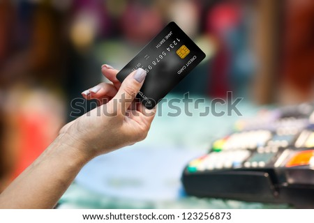 close up of woman hand holding credit card #123256873