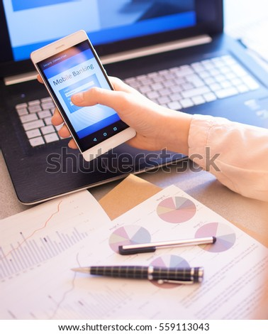 Close up of woman hand using on line banking on mobile phone logging in to a bank account typing password. Business, financial and secure payment concept. #559113043