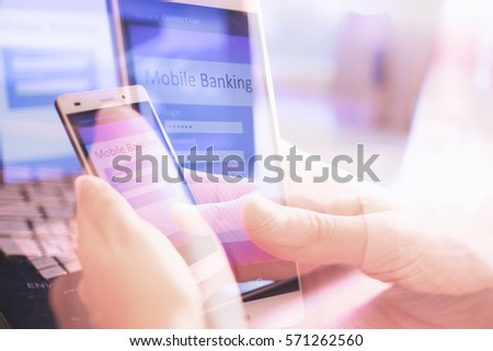 Close up of woman hand using on line banking on mobile phone logging in to a bank account typing password. Business, financial and secure payment concept abstract background. #571262560