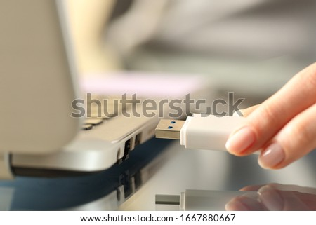 Close up of woman hands connecting usb flash drive on a laptop computer Stock photo ©