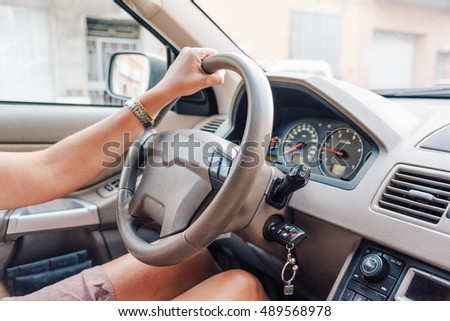 Close up of woman hands driving a car. #489568978