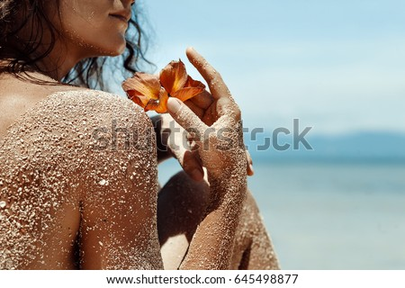 Close up of woman hands holding flower. Spa vacation concept #645498877