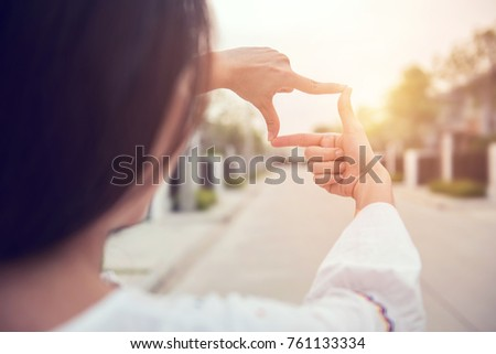 Close up of woman hands making frame gesture with sunlight outdoor, Future planning concept. #761133334
