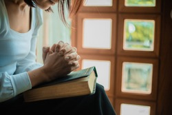 Close up of woman hands pray at church, Woman believe and pray to God.
