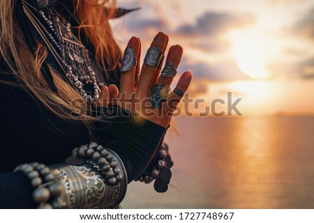 close up of woman hands. tribal style woman on the beach at sunset Foto d'archivio ©