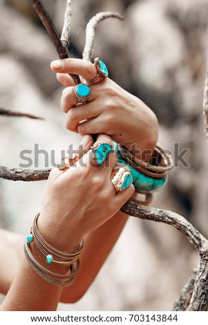 close up of woman hands with boho accessories #703143844