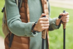 Close-up of woman holding sticks and walking on fresh air